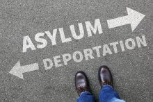 Asylum/ deportation arrows in different directions with a pair of feet: the 4 worst immigration problems