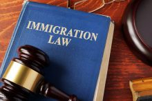Book with title immigration law on a table. immigration attorney