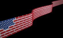 American flag as a brick wall . Immigrants add to our economy why are we trying to stop them?