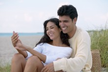 K-1 Visas: the finacee visa shows a Couple hugging on the beach