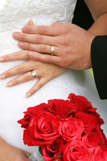 Can I still be deported if I marry a US citizen? Two hands with wedding rings and roses