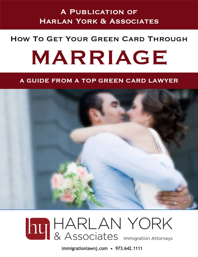 Free guide for Green Cards Through Marriage cover with a couple in wedding attire kissing